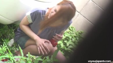 redhead Asian outdoor wanking