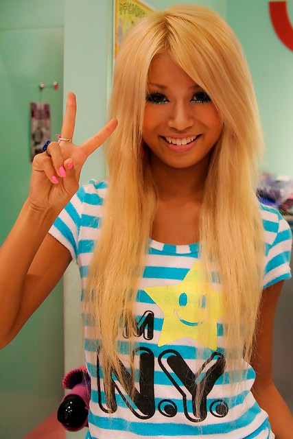 otngagged blonde Asian woman